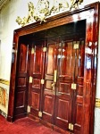 amazing old wood doors to private booth at national theater in san jose costa rica