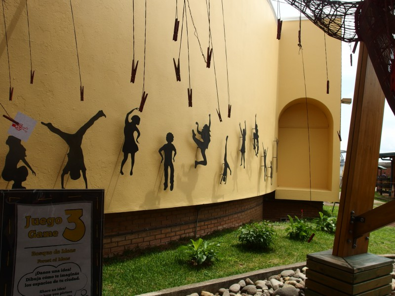 Wall of iron cutouts of children playing, a new wall at the Children's Museum in Costa Rica.